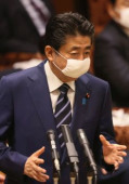Prime Minister Shinzo Abe attends Upper House s audit committee session April 1 2020 Tokyo Japan  Japanese Prime Minister Shinzo Abe wearing