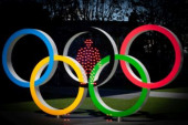 Tokyo Olympics postponed due to coronavirus pandemic In this multi exposure picture the Olympic rings and red light are seen in Tokyo Japan on March