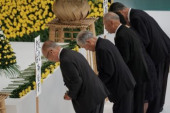 Japan holds annual official service for war victims on 72nd anniversary of the end of World War II August 15 2017 Representatives inclines in front